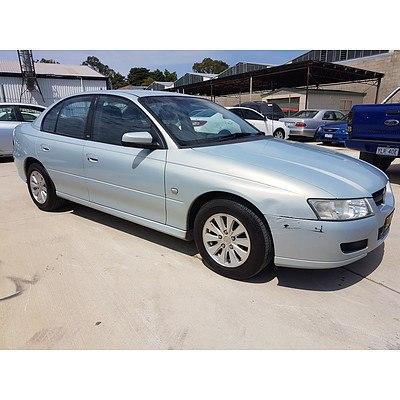 4/2006 Holden Commodore Acclaim VZ MY06 4d Sedan Silver blue 3.6L