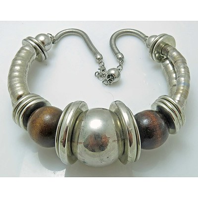 Dramatic designer necklace - silver tone with wooden beads.