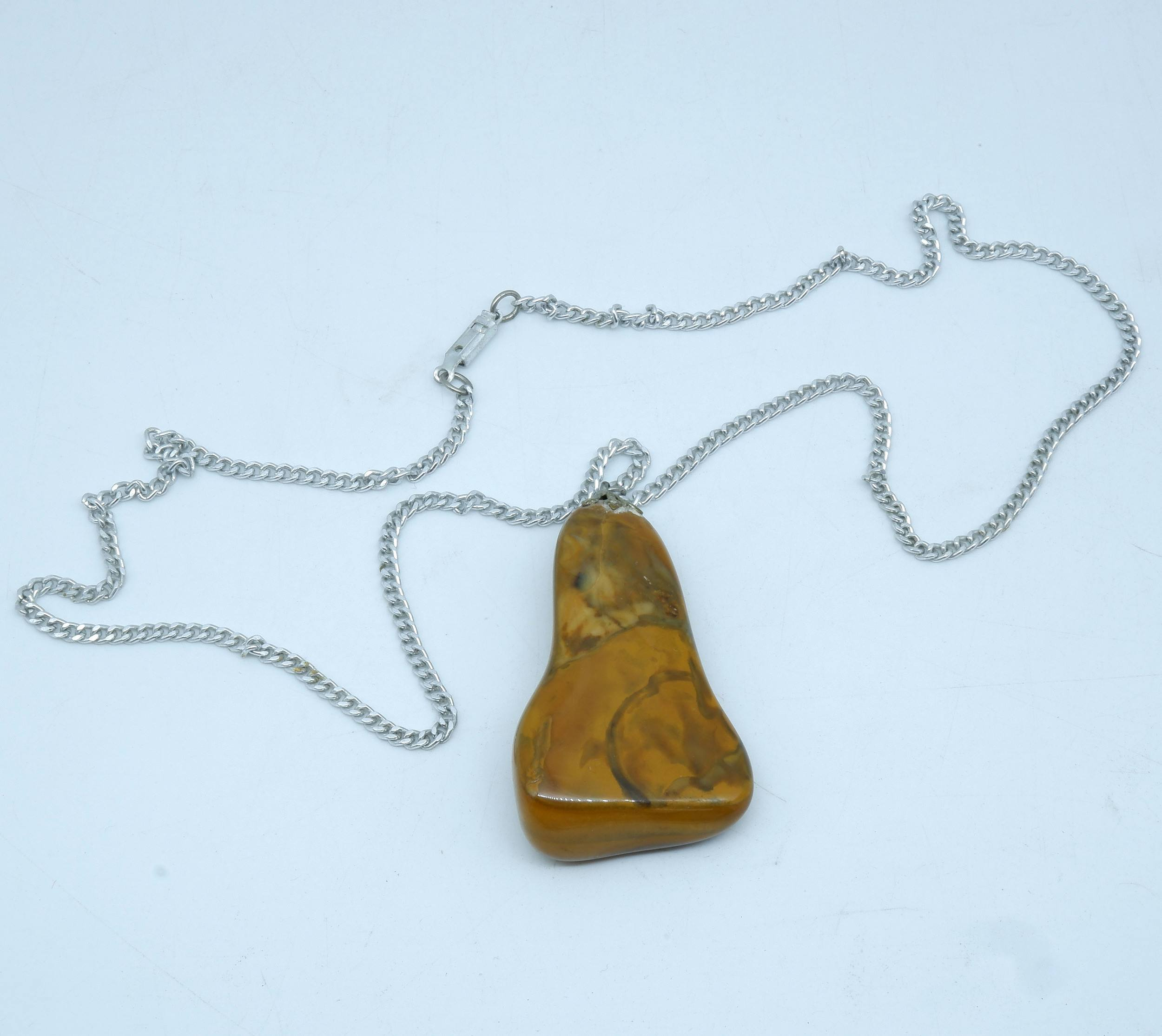 'Aboriginal Polished Stone on Silver Chain, Made by Post-Primary Class at Papunya'