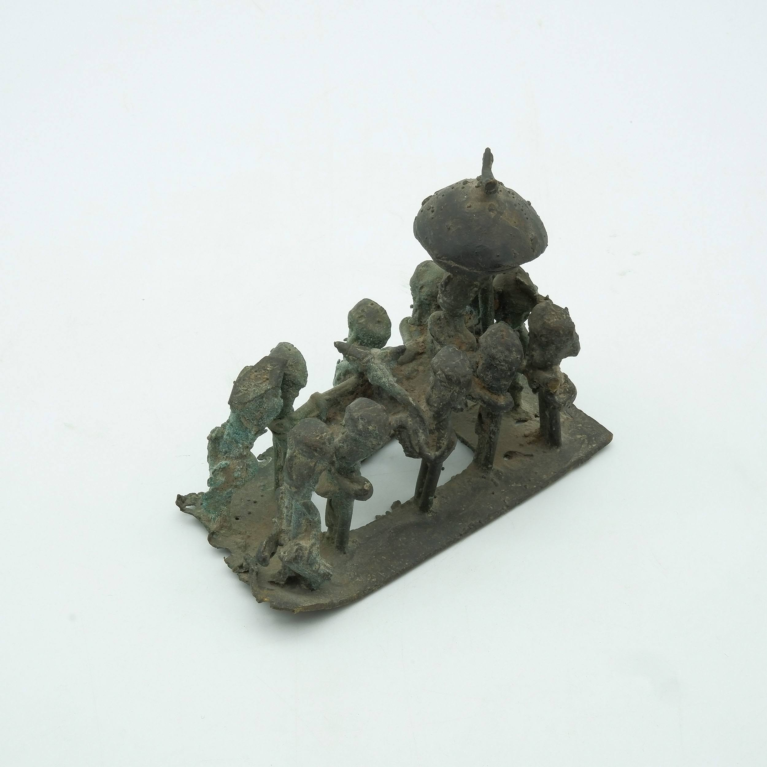 'West African Iron Model of King on Carrying Chair '