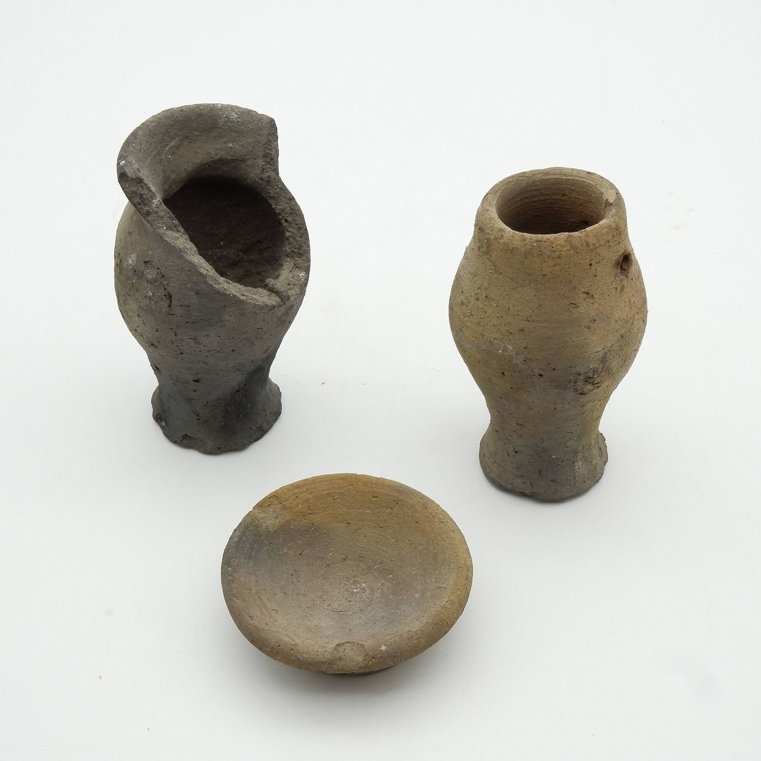 'Two Ancient Egyptian Jars and Votive Dish'
