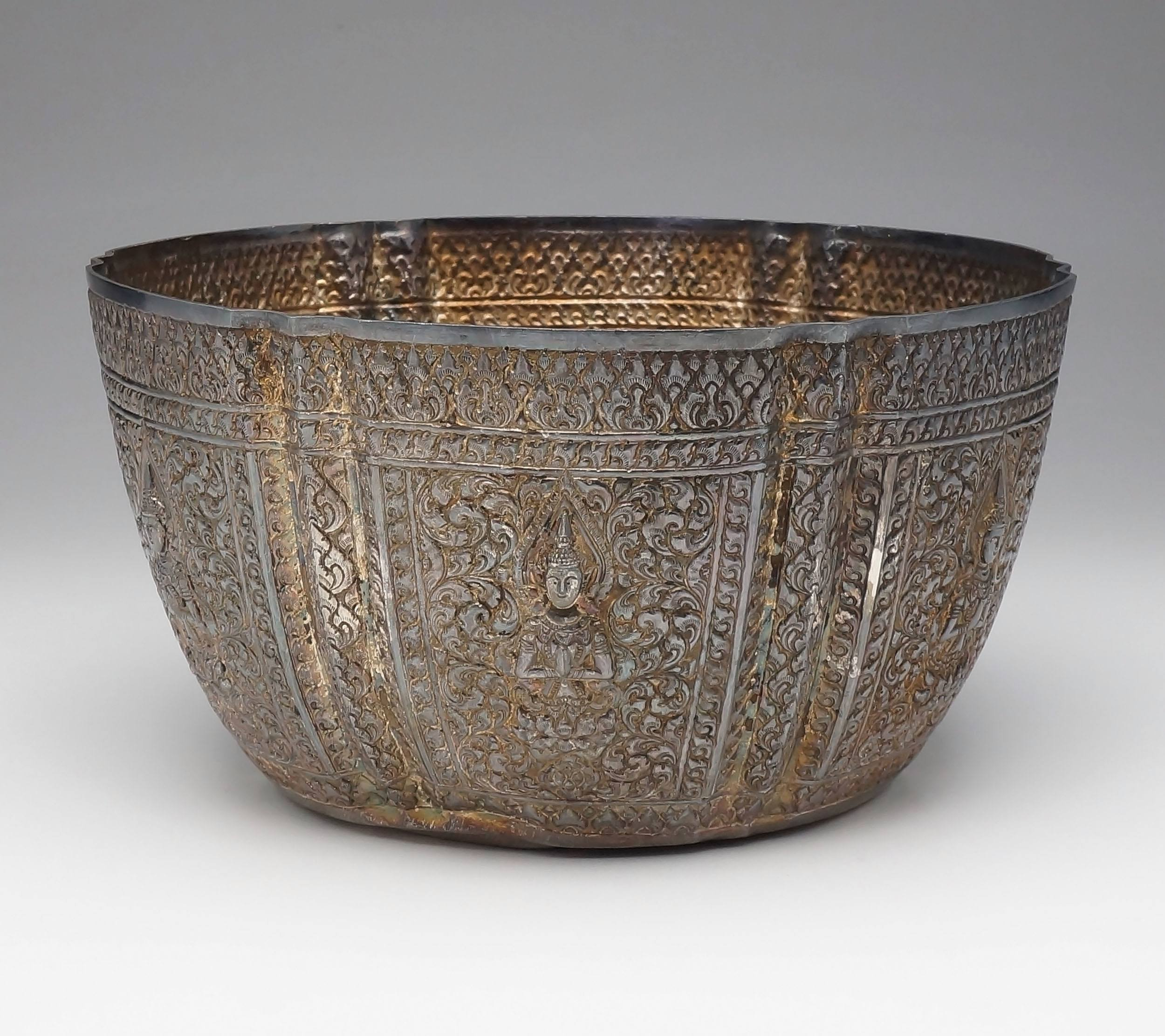'Lao Silver Repousse Rose Bowl Decorated with Six Praying Thepphanom Figures Seated on Lotus Flowers Surrounded by Scrollwork'