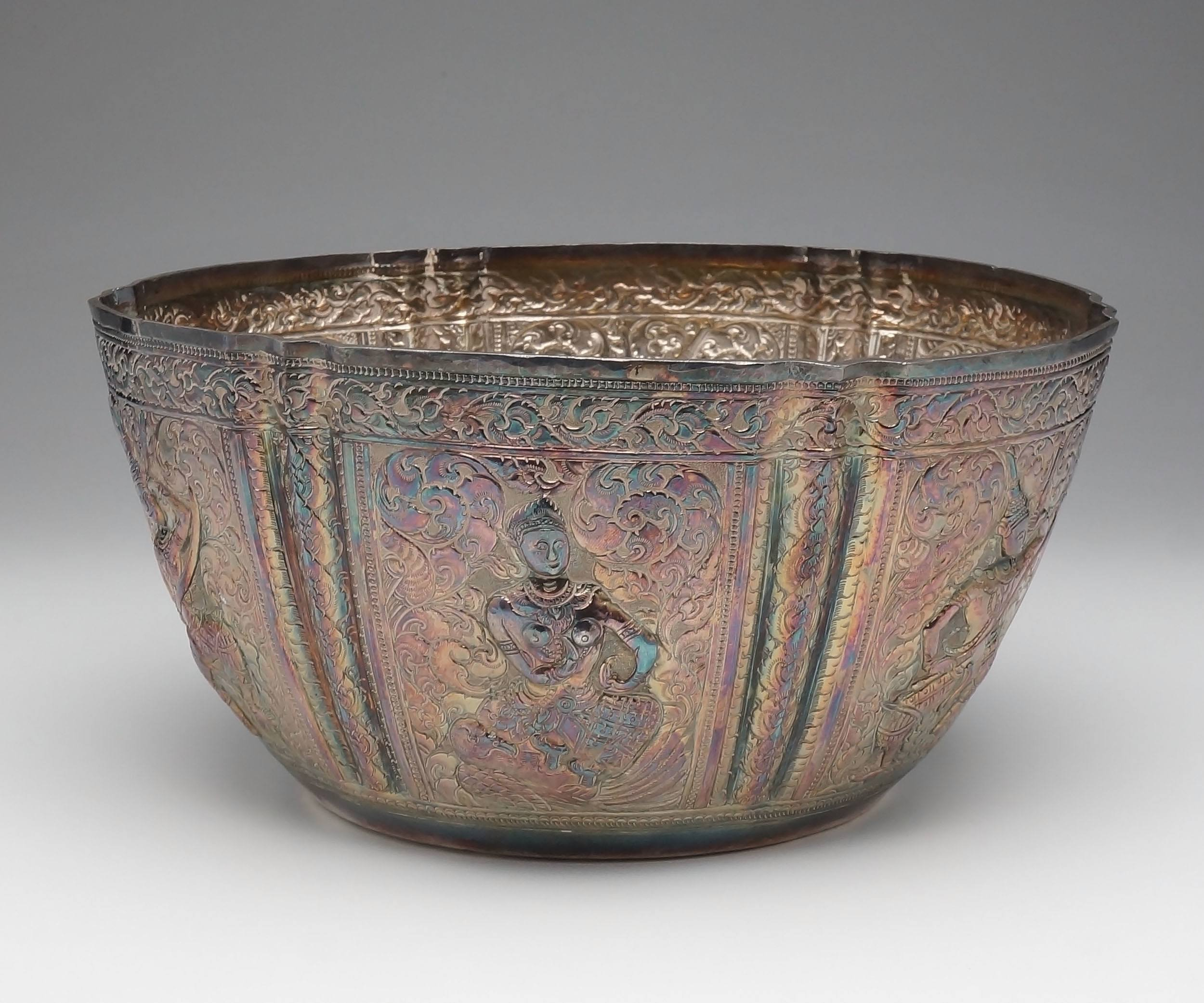 'Lao Silver Rouposse Rose Bowl with Six Facades of Alternating Warrior Figures Surrounded by Scrollwork'