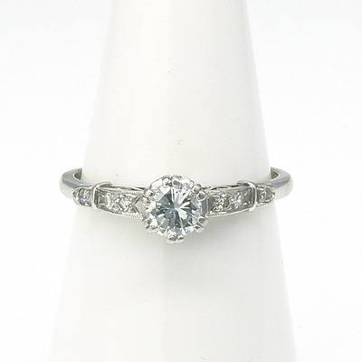 18ct Platinum Ring with Round Brilliant Cut Diamond in Six Double Claw Setting with Uplifted Shoulders each with Three Single Cut Diamonds