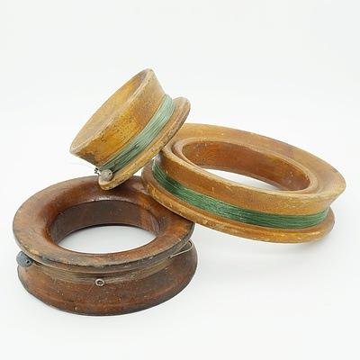 Three Vintage Carved Fishing Reels