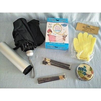 Pamper Yourself: Tubie Twist absorbent microfibre hair towl, exfoliating glove, estee lauder makeup brushes, pill organiser and umbrella