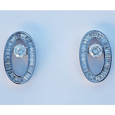 A Superb Pair of 18ct White Gold Diamond Stud Earrings with Removable Oval Frame of Baguette and Tapered Baguette Diamonds