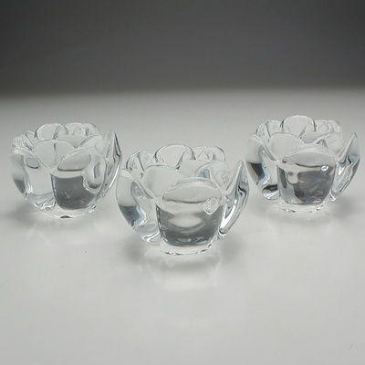 One Large and Three Small Royal Copenhagen Crystal Lotus Candleholders