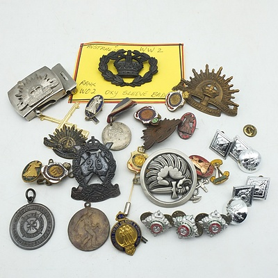 A Group of Australian and International Pins and Badges, Including a Australian WWII Sleeve Badge, 50 Years Commonwealth of Australia Medallion and More