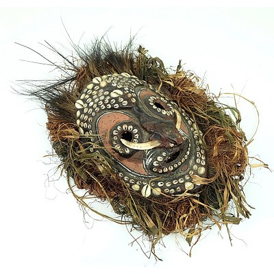 Sepik Mud Overlaid Turtle Shell Mask with Feather and Shell Adornments, Papua New Guinea