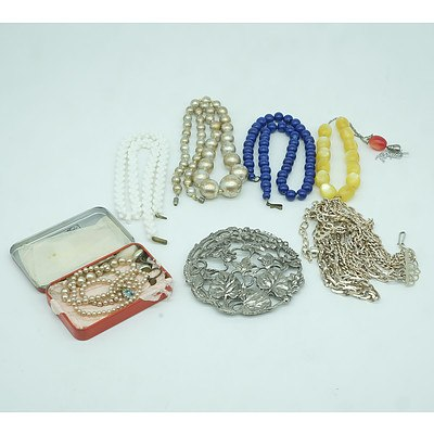 Group of Costume Jewellery Including Necklaces and a Floral Brooch