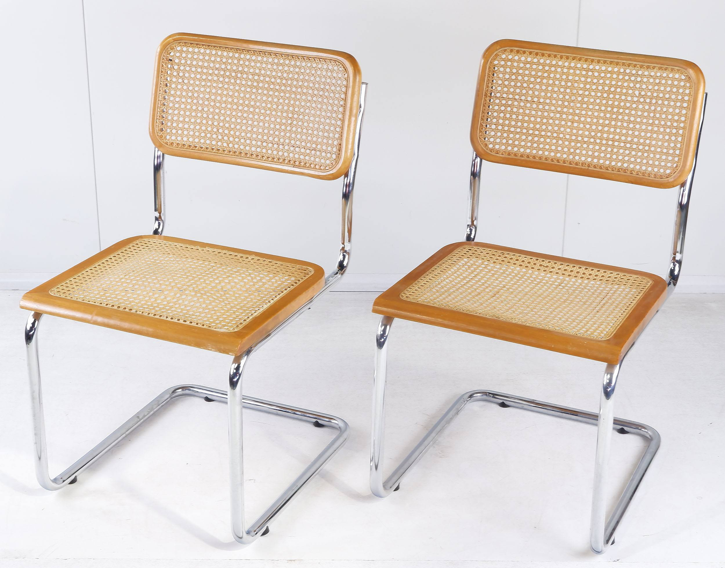 'Pair of Marcel Breuer Chromed Tubular Steel and Woven Rattan Cantilever Chairs'
