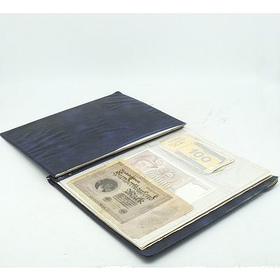 Coin Album with Various International Coins and Notes, Including France, Singapore, Germany and More