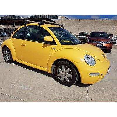 2/2003 Volkswagen Beetle 1.6 9C 3d Hatchback Yellow 1.6L