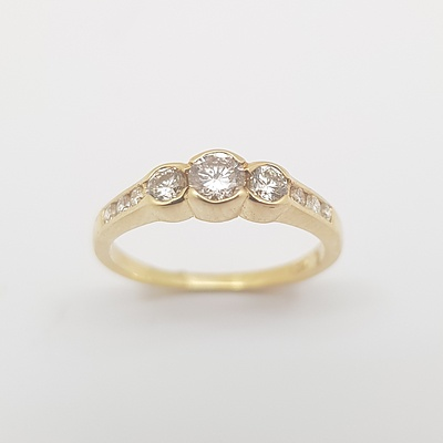 18ct Yellow Gold Diamond Ring with Flat Band Set with 3 Brilliant Cut Diamonds in Each Shoulder And 3 Brilliant Cut Diamonds Set in the Centre