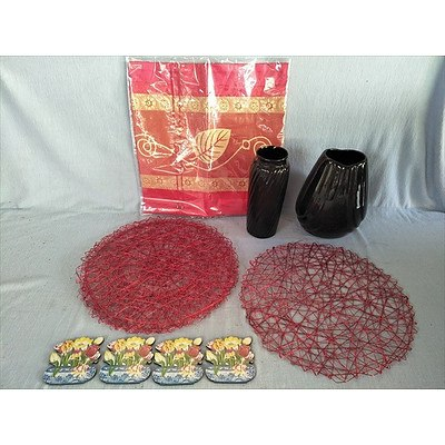 Assorted homewares including vases, placemats, cushion cover and coasters