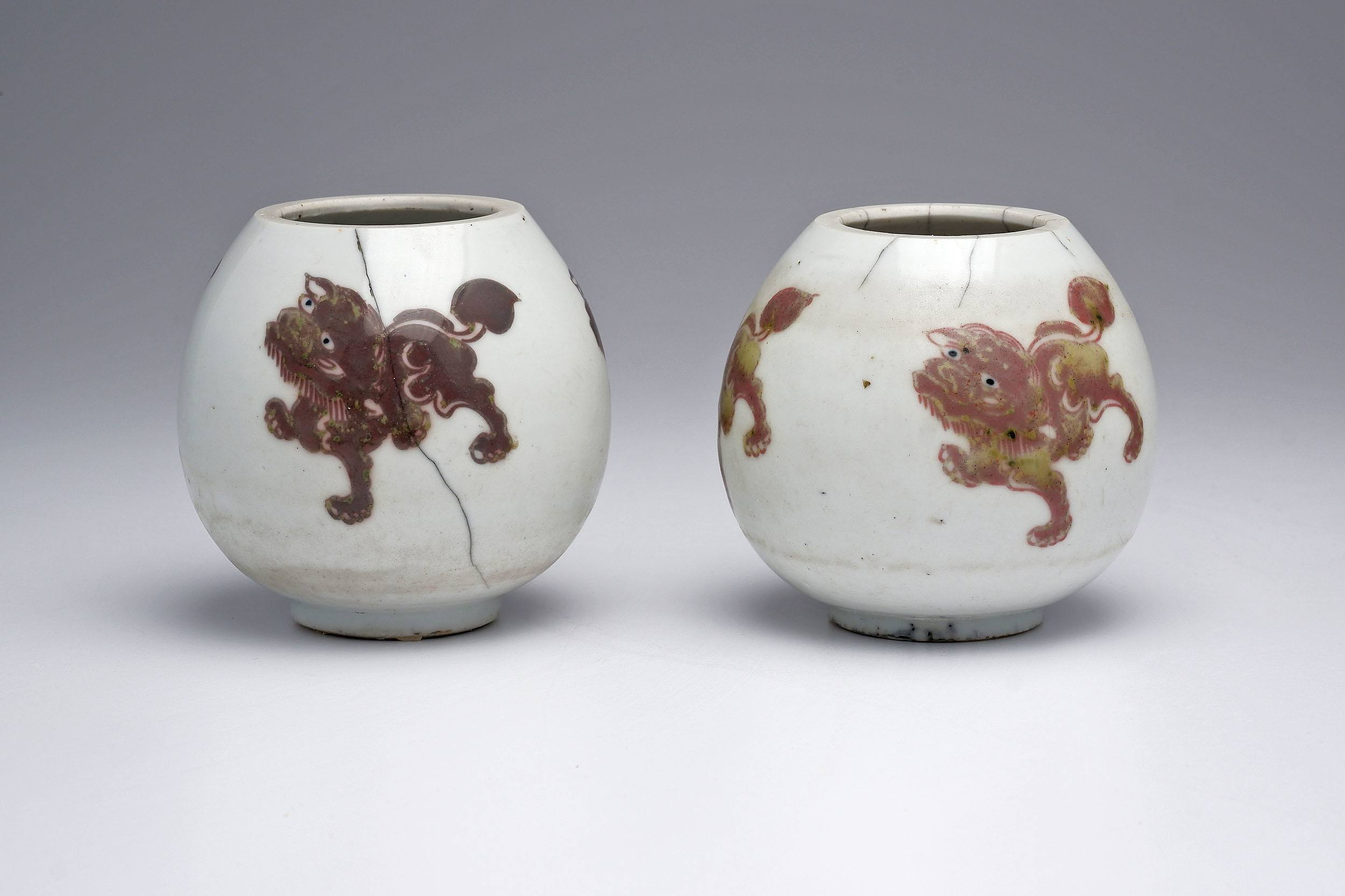 'Rare Pair of Chinese Water Pots Decorated with Buddhist Lions in Underglaze Copper Red, Probably Kangxi Period, 18th Century'