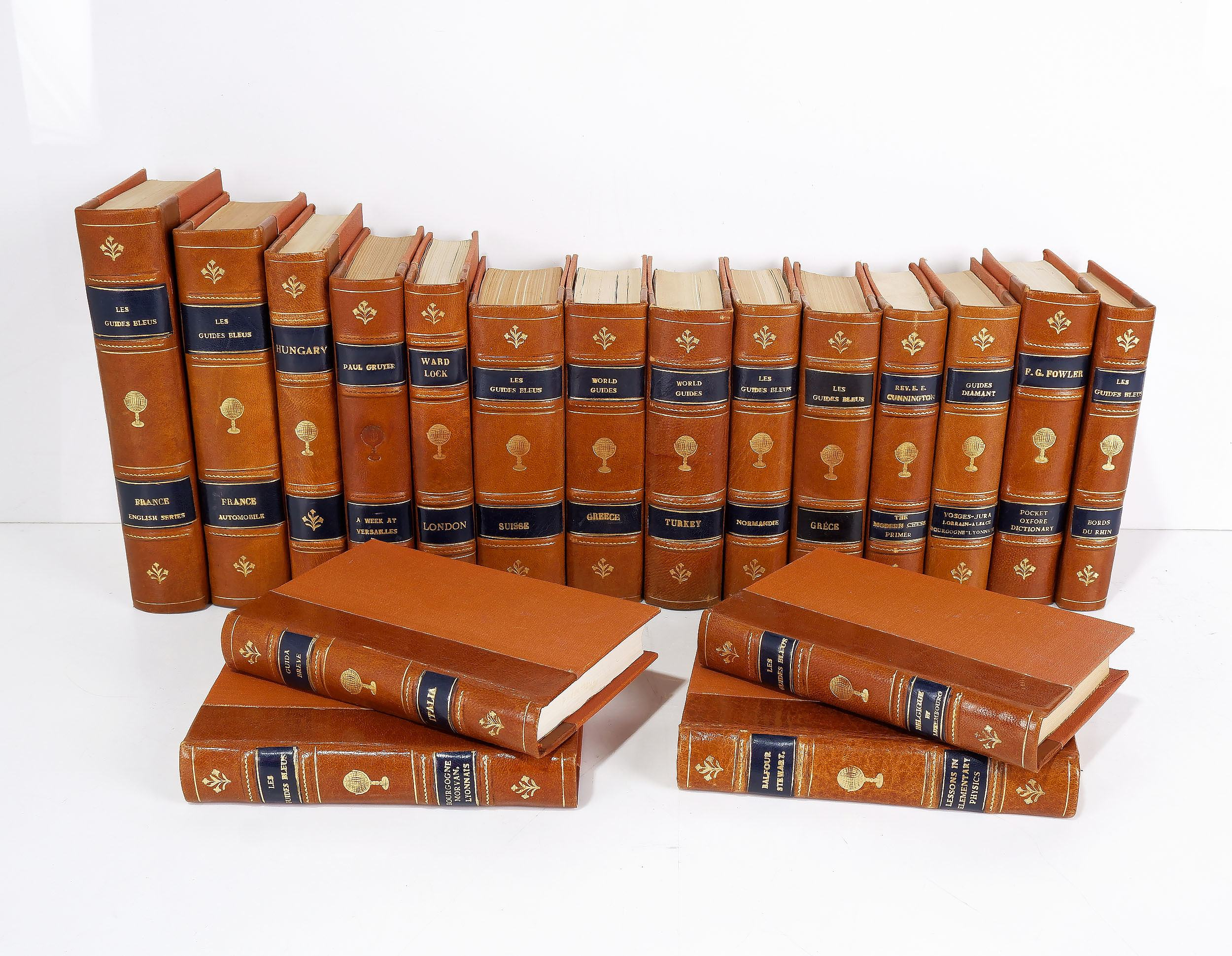 'Eighteen Various Gilt Tooled Leather Bound Books Including Les Guides Bleus, World Guides and More'