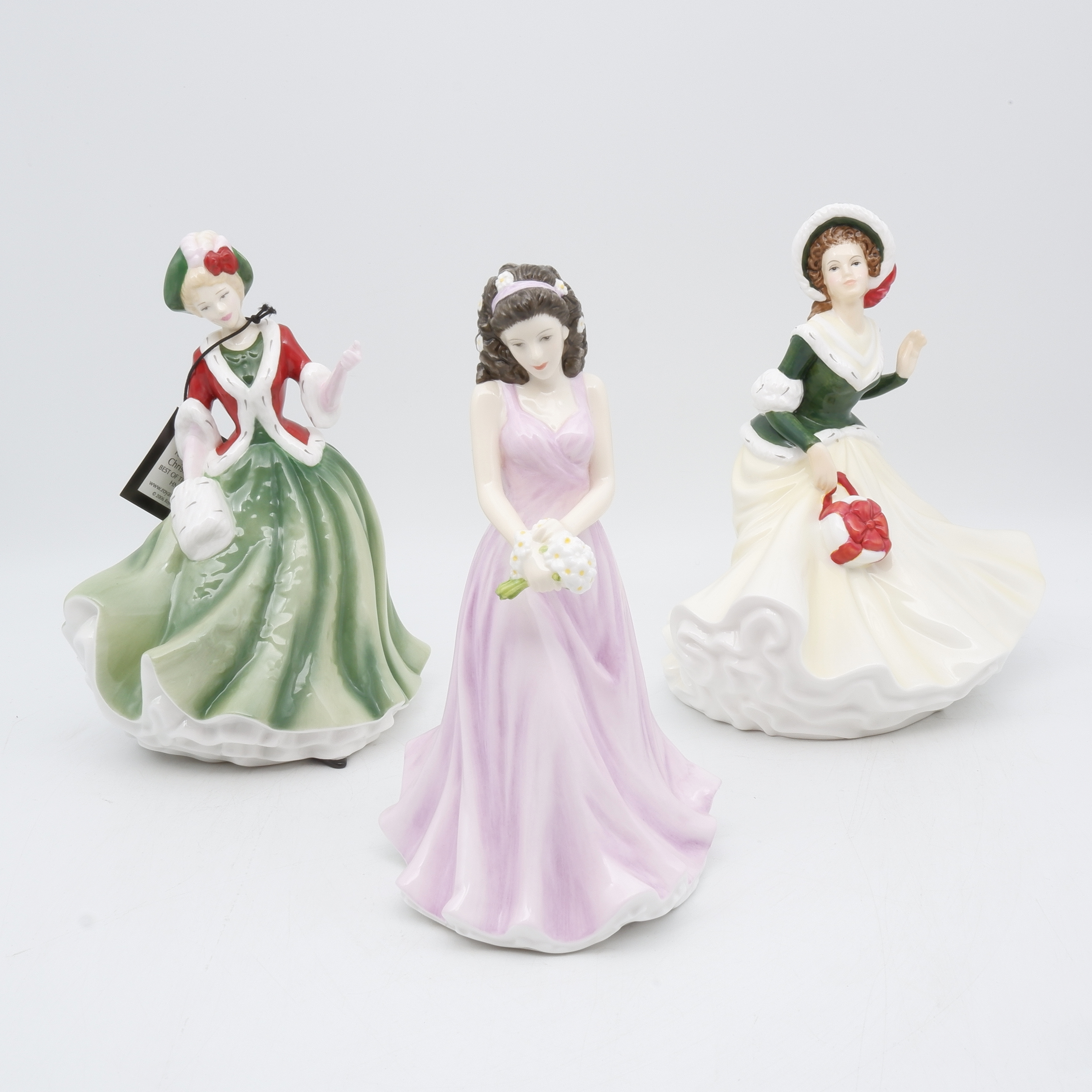 Three Royal Doulton Figures Including Pretty Ladies Christmas Day, Pretty  Ladies Christmas Day 2008 and Flower of the Moth April - Daisy Innocence
