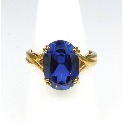 9ct Yellow Gold Ring With Oval Blue Synthetic Gem in Four Claws