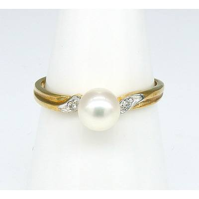 9ct Yellow Gold Ring with a Round Cultured Pearl and a Small Brilliant Cut Diamond in Each Shoulder