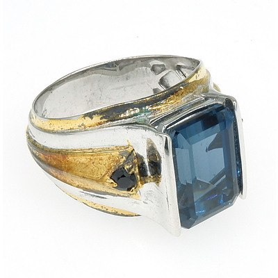Sterling Silver Ring with Emerald Cut Synthetic Blue Gem