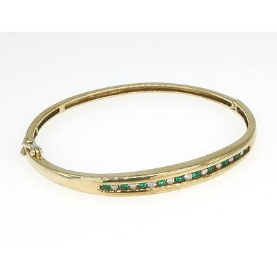 9ct Yellow Hold Hinged Bangle with a Row of Round Synthetic Green Emeralds and Round Brilliant Cut Diamonds