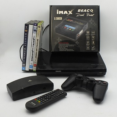 Phillips Blu-Ray/ DVD Player, Imax Dual Power Charger, Playstation Controller and Various DVDs and Xbox 360 Game