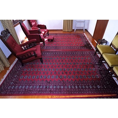 A Large Hand Knotted Wool Pile Bokhara Rug