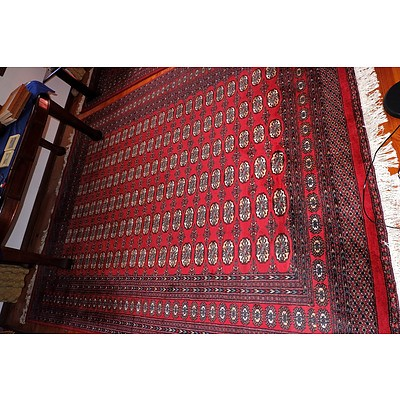 A Large Hand Knotted Wool Pile Bokhara Rug Similar To The Previous Lot
