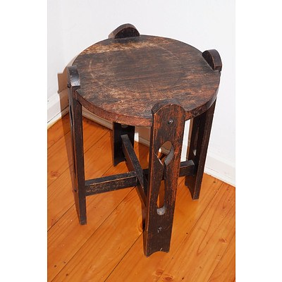 A Small Oak Arts and Crafts Period Plant Stand with Pierced Supports