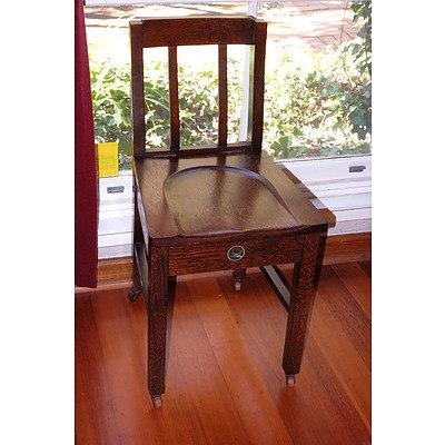 An Antique Oak Sewing Chair with Original Bluebird Decal