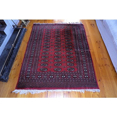A Hand Knotted Wool Pile Bokhara Rug