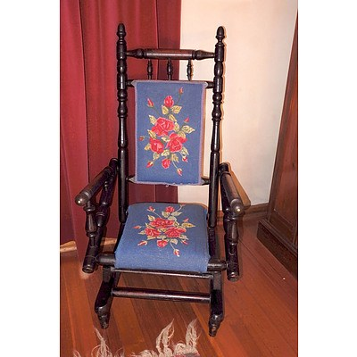 An Antique Ebonized Oak Rocking Chair with Tapestry Upholstery