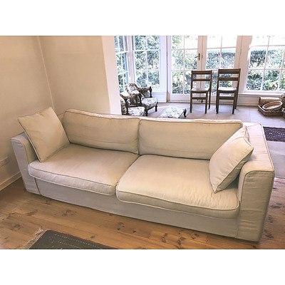 A Contemporary Linen Slip Covered Three Seater Sofa