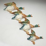 A Set of Four Flying Beswick Porcelain Wall Ducks