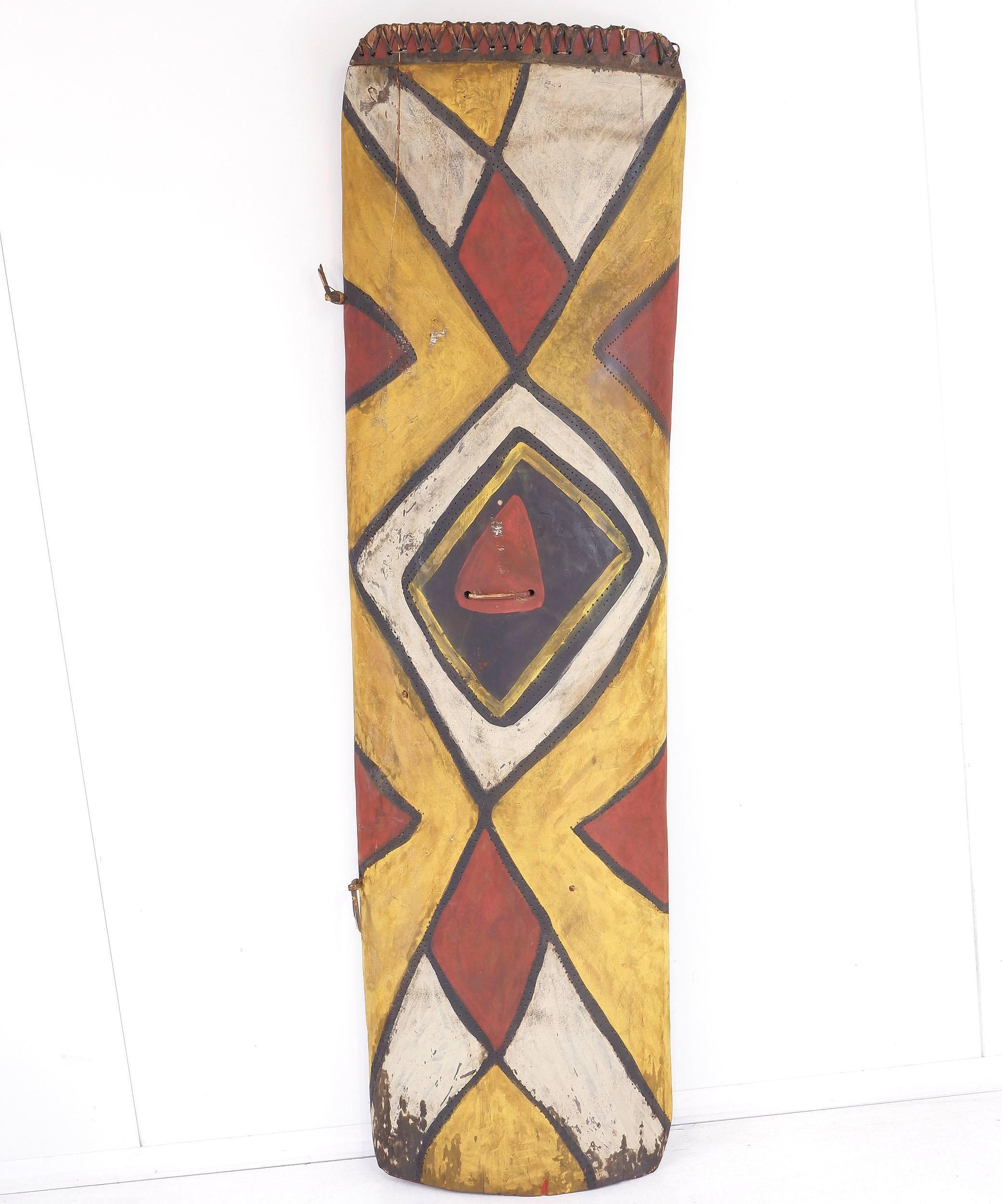 'Mendi War Shield, Ochre Decorated Wood and Fibre, Papua New Guinea 20th Century'