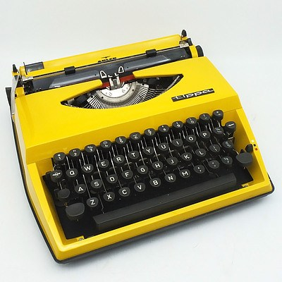 Vintage Adler Tippa Portable Typewriter in Canary Yellow