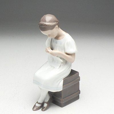 Bing Grondahl and Porcelain Ceramic Figure of a Girl Knitting