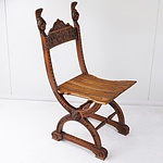 Campaign Chair with Scroll Work and Carved Head Finials