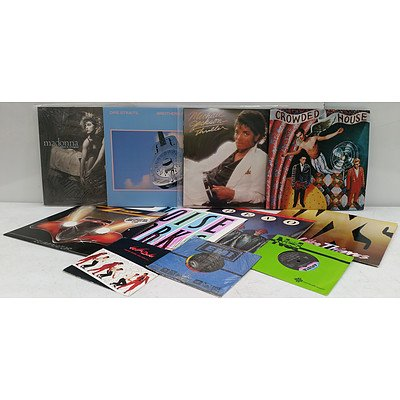 Approximately 40 Chart Topping Vinyl Records & Singles.