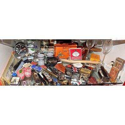 Shelf Lot Including Pocket Knifes, Lighters, Zippos, Jaguar Money Clip and More