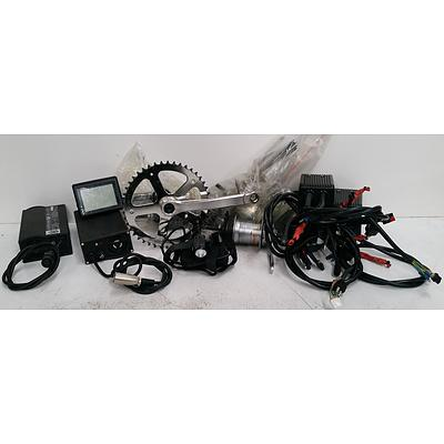 Assorted Box Of Electric Bike Accesories Including Battery Chargers, Hubs & More.