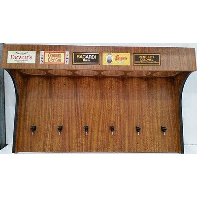 Wall Mount Spirit Dispensing Cabinet and Framed Carlton Beer Poster