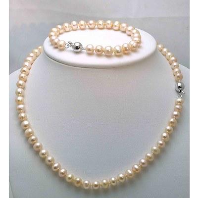 Peach-coloured Cultured Pearl Necklace & Bracelet set