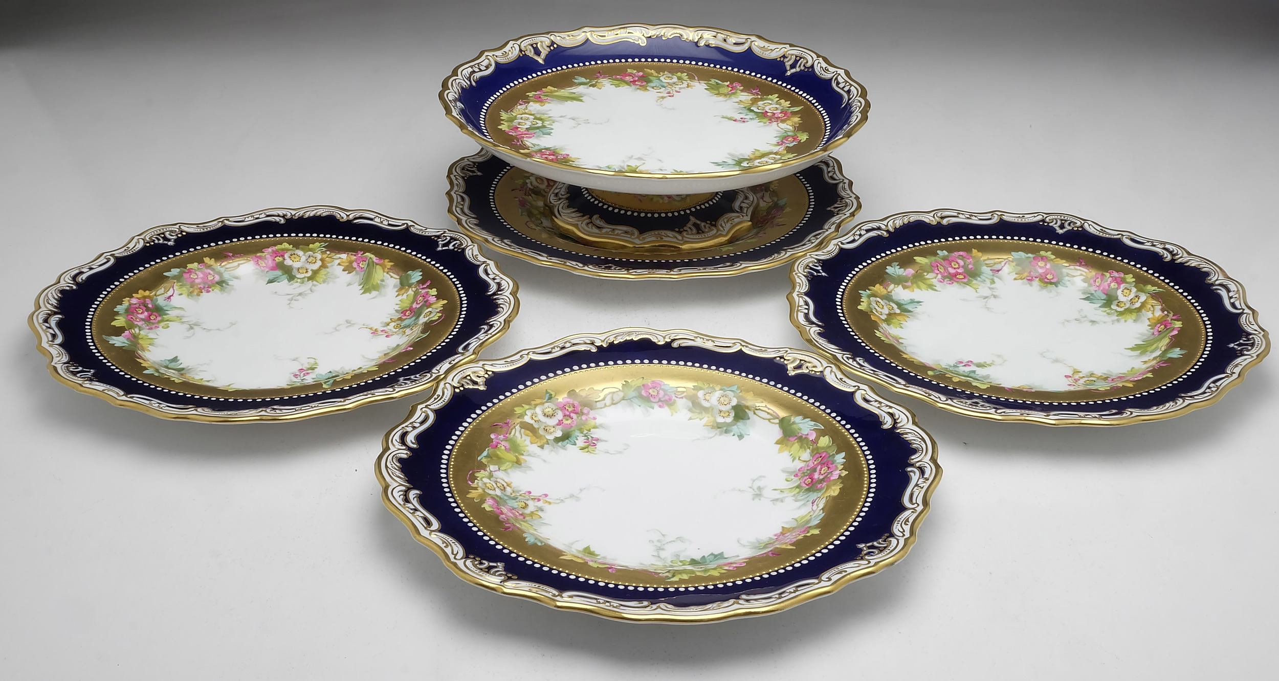 'Four Antique Copland Hand Painted Plates and a Matching Comport'