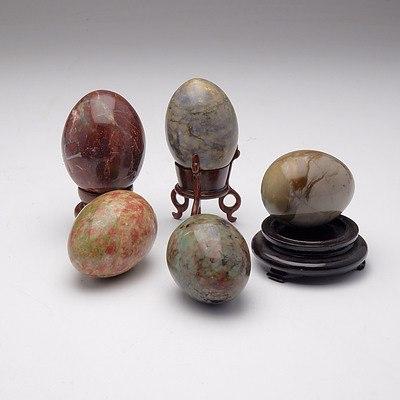 Five Semi Precious Stone Eggs and Three Stands