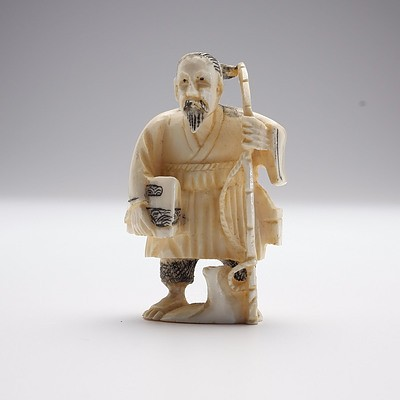 Small Carved Ivory Man with Rod