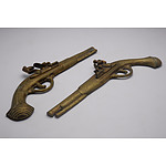 Two Vintage Brass Ornamental Gun Wall Plaques