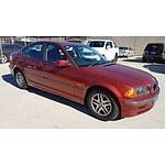 4/2000 BMW 318i E46 4d Sedan Red 1.9L